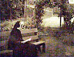Sister reading before tennis courts, 1962